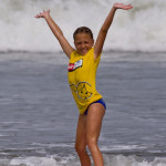 "Surfer Girl Makes a ""Big Splash"" at Kuta Beach"